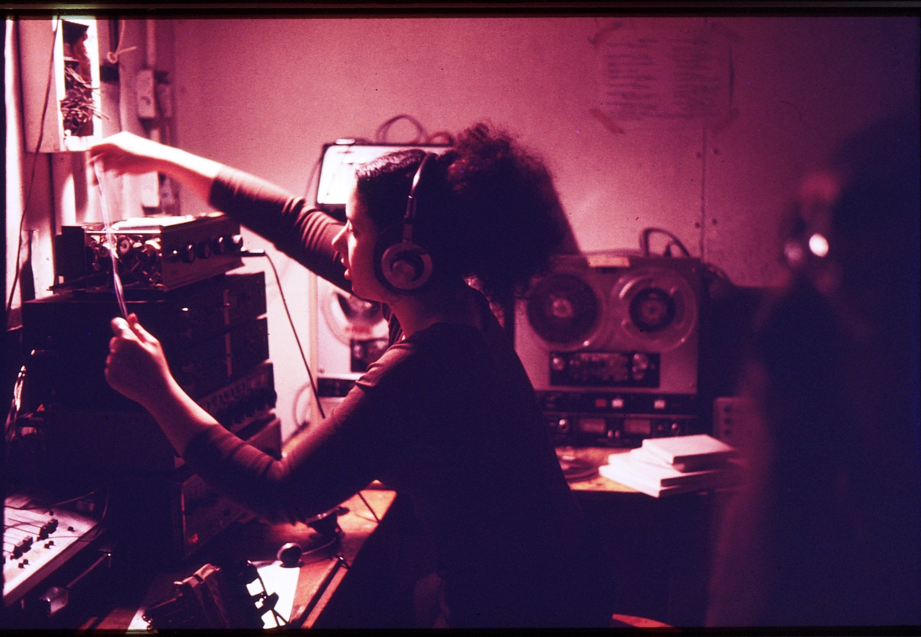 SIM alum Amy Cotton teching a show in the projection booth in the Longwood Theater. During her time at MassArt, Cotton was a participant in the ZONE production of Kandinsky's Yellow Sound at the Guggenheim Museum in NYC.